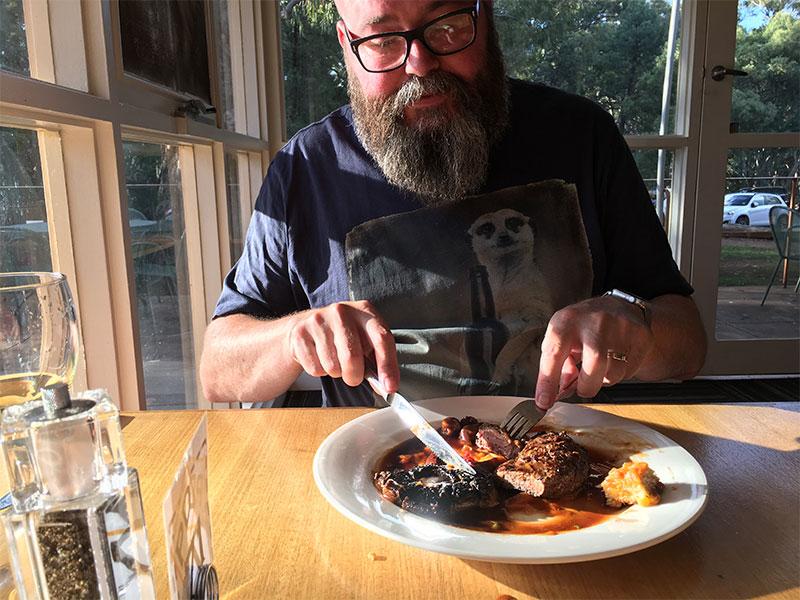 David savoring his meal of Kangaroo